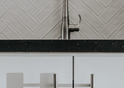 Project Details - Sink, Cabinet and Chevron Tile Background
